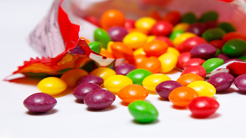 The 5 Absolute Worst Foods to Eat in Your Car candy spilling from bag